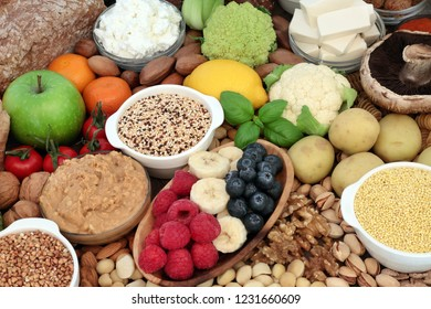 Health food for vegans with grains, almond butter & yoghurt, tofu bean curd, nuts, fruit, vegetables,  wholegrain bread. High in antioxidants, dietary fibre and omega 3.