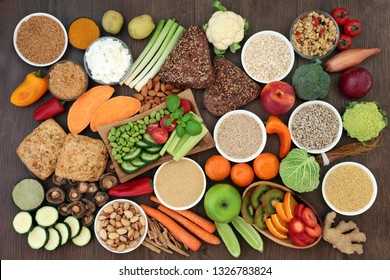 Health food for vegans with grains, seeds, nuts, peanut butter, almond yoghurt, herbs, spice, vegetables, fruit, cereals, wholegrain bread rolls. High in antioxidants, protein, dietary fibre & omega 3