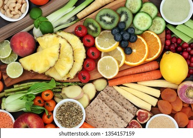 Health food for weight loss concept with fruit and vegetables, whole grain crackers, grains, legumes, whole wheat noodles, herbs, spice, nuts and supplement powder. Top view.