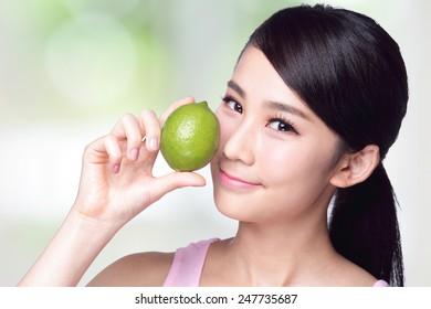 Health girl show lemon with smile face, health food concept, asian woman beauty