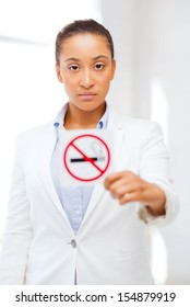 health and healthcare concept - picture of african woman with restriction no smoking sign