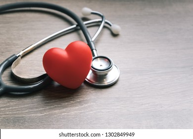 Health heart check up. Red heart and medical equipment on wooden table and copy space used for add messages. Health care services.