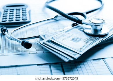 Health insurance application form with banknote and stethoscope concept for life planning. Blue toned