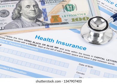 Health insurance application form with stethoscope and calculator