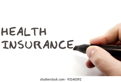 Health Insurance being written with a black marker on a dry erase board.