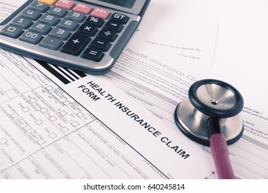Health insurance claim form with calculator and stethoscope concept for life planning