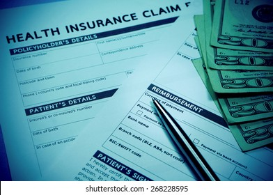 Health insurance claim form with money for health insurance concept