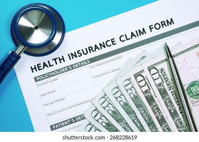 Health insurance concept with claim form and money