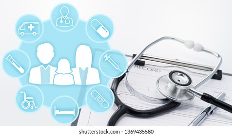 Health insurance concept. Medical icons around family icons. Stethoscope on medical record.