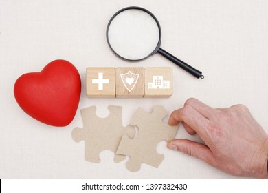 Health insurance concept, search, interactions, young man hand arranging wood block stacking with icon healthcare.