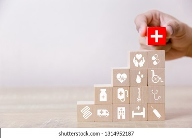 Health Insurance Concept,hand arranging wood block stacking with icon healthcare medical,for health.