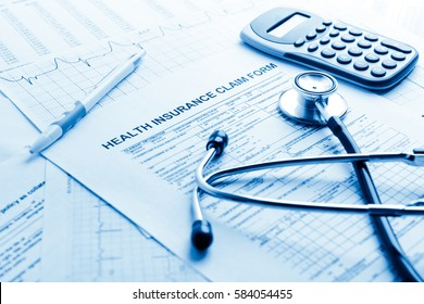 Health insurance form with stethoscope concept for life planning. Blue toned