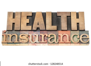 health insurance - healthcare concept - isolated text in vintage letterpress wood type printing blocks