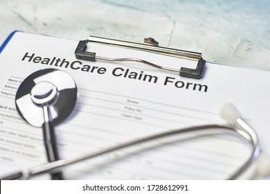 Health Insurance Industry. Individual medical health insurance policy and stethoscope