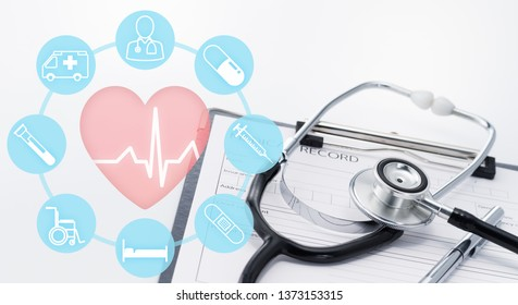 Health insurance and medical care concept. Medical icons and stethoscope on medical record.