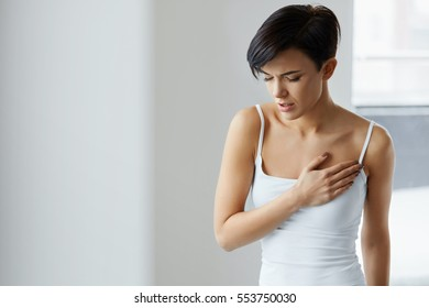 Health Issues. Beautiful Young Woman Having Heart Attack, Feeling Strong Pain In Chest. Portrait Of Female Suffering From Painful Lung Feeling Or Heart Disease. Healthcare Concept. High Resolution