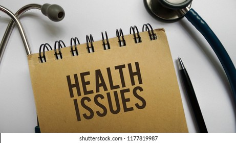 Health issues memo written on a white background with stethoscope and pen