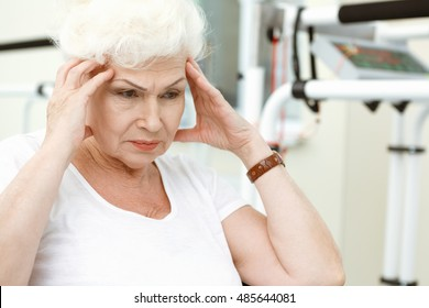 Health issues might be depressing. Shot of a stressed elderly woman rubbing her temples copyspace on the side