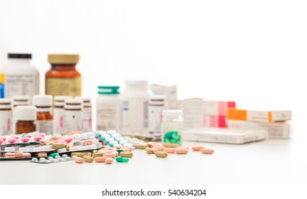 Health, medicine. Colorful pills and supplements on white background
