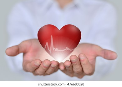 Health, medicine, people with heart disease, the hands holding red 3D close-up