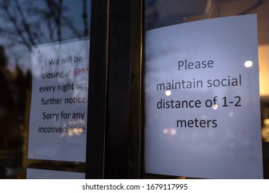 A health notice sign in the front of a store mandating social distancing measures in response to the Coronavirus pandemic.