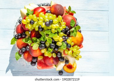 health plate, fruit plate grapes, melon, mint, banana, peaches, nectarines, watermelon