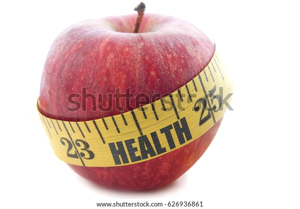 Health printed on a measuring tape wrapped around an apple