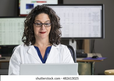 Health professional entering data into computer