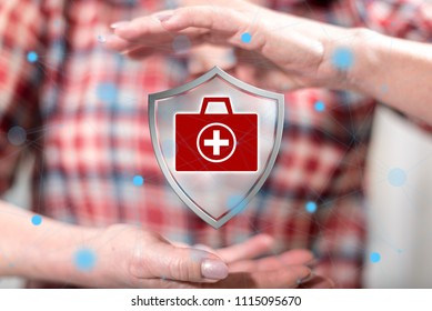 Health protection concept between hands of a woman in background
