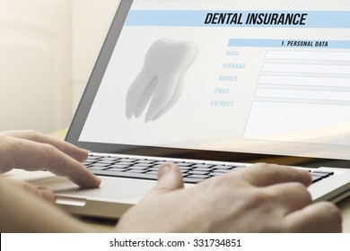 health protection concept: man using a laptop with dental insurance on the screen. Screen graphics are made up.