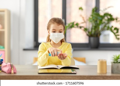 health protection, education and pandemic concept - sick student girl in protective medical mask with hand sanitizer and notebook at home