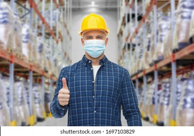 health protection, safety and pandemic concept - male worker in safety helmet wearing face protective medical mask over warehouse background