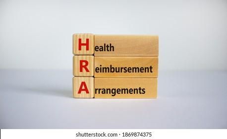 Health Reimbursement Arrangement symbol. Wooden cubes and blocks with words 'HRA, Health Reimbursement Arrangement'. Beautiful white background, copy space. Business and HRA concept. - Shutterstock ID 1869874375
