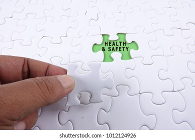 Health and safety concept: Missing piece of puzzle on white background