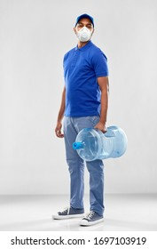 health, safety and pandemic concept - happy indian delivery man with water barrel wearing face protective mask or respirator for protection from virus disease over grey background
