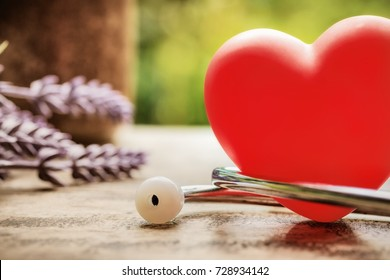 Health and safety. Red heart and Stethoscope on wooden table with natural background. Take control of your health concept. picture for add text message.