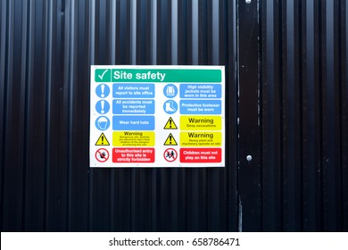 Health and Safety signs on wall outside construction site