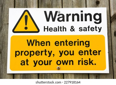 Health and Safety warning sign advising that you enter a building at your own risk.
