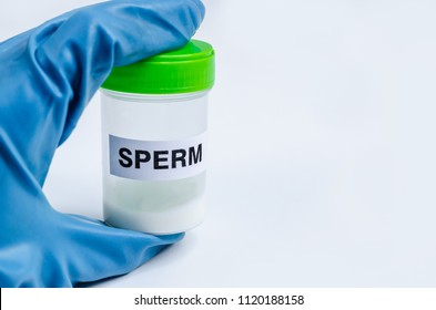 Health. Sample sperm. Donor Sperm Close up Concept Bank Sperm Doctor in the Glove holds Jar Container With Semen Analyze the Motility Spermatozoa. Man Infertility.