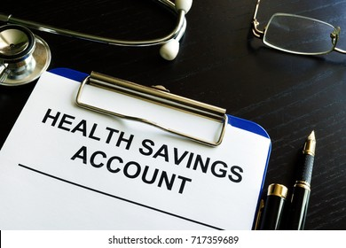 Health savings account HAS form in a clipboard.