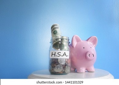 Health Savings Account ( HSA ) coin jar with piggy bank