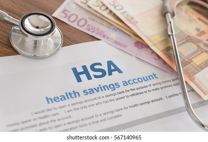 health savings account HSA concept with application form,euro money, stethoscope on desk.