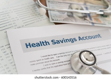 health savings account HSA concept with application form,dollar money, stethoscope, bank account on desk.