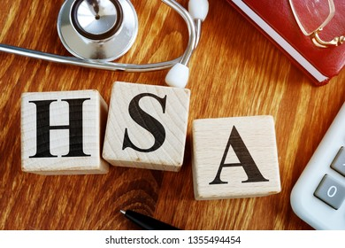 Health Savings Account HSA letters from wooden blocks.