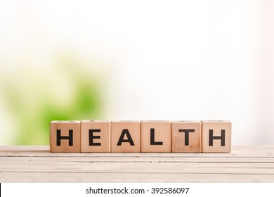 Health sign made of wood on a natural desk