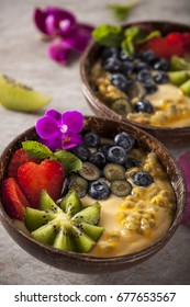 Health smoothie with passion fruit and berry, decorated with mint and