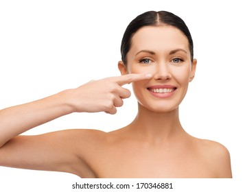 health, spa and beauty concept - clean face of beautiful young woman pointing to her cheek
