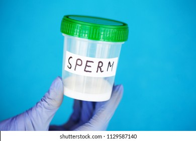 Health. Sperm Analysis. Concept of Bank Sperm. Infertility. Doctor's Hand Holding Container for Analyzes.