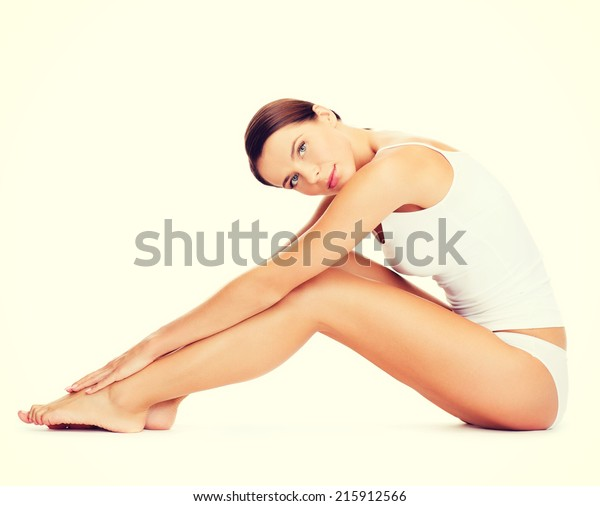 health, sport and beauty concept - sporty woman in cotton underwear doing exercises