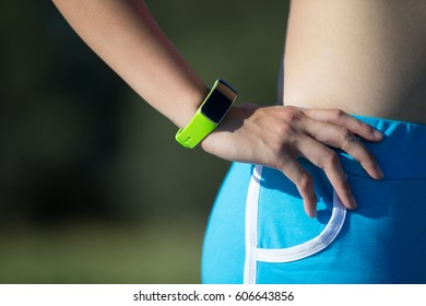Health sport woman wearing smart watch device with touch screen doing exercises
